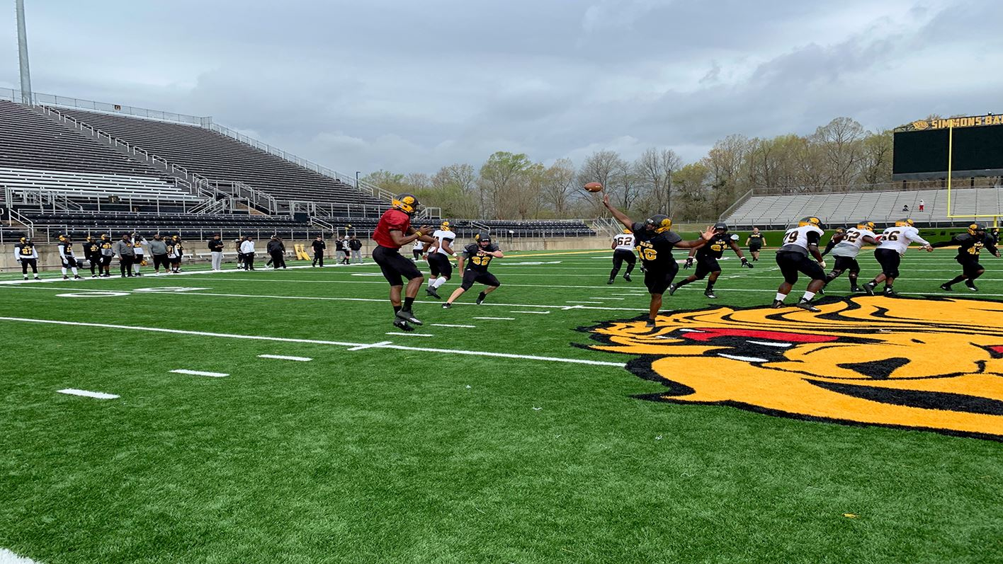 spring football practice action